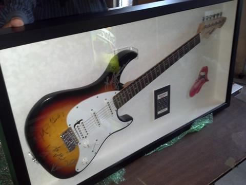 autographed stones guitar